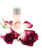 Essential oil with dry rose — Stock Photo