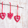 Royalty-Free Stock Photo: Hearts hanging  on a twig