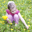 Young girl in a field of dandelions — Stock Photo