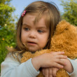 Stock Photo: Child with toy bear cub