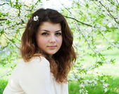 Young girl in the spring garden — Stock Photo