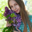 Royalty-Free Stock Photo: Beautiful girl with lilac flowers