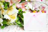 Alstroemeria flowers with a white card — Stock Photo