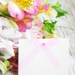 Alstroemeria flowers with a white card — Stockfoto