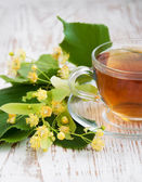 Cup of tea and linden flowers — Stock Photo