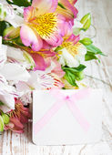 Alstroemeria flowers with a white card — 图库照片