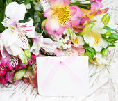 Alstroemeria flowers with a white card — Foto Stock