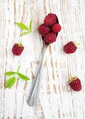 Raspberries on a spoon — Stock Photo