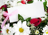 Flowers with a white card — Stock Photo