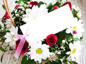 Flowers with a white card — ストック写真
