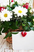 Flowers with a white card — Stok fotoğraf