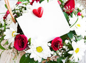 Flowers with a white card — Foto de Stock