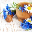 Mortar and pestle with cornflowers — Stock Photo