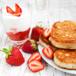 Fresh strawberries  pancakes and yogurt — Stock Photo