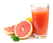 Grapefruit juice and ripe grapefruits — Stock Photo