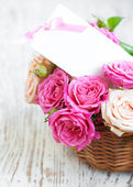 Card with roses on the table — Stock Photo