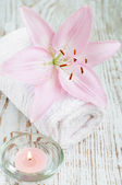 Lily flower and candle — Stock Photo