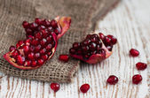 Burlap sack with pomegranate — Stock Photo