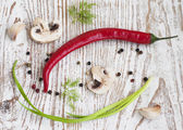 Chilis, onion,  mushrooms and garlic — Stock Photo