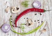 Chilis, red onion,  mushrooms and garlic — ストック写真