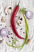 Chilis, red onion,  mushrooms and garlic — Stock Photo