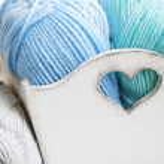 Crochet hook and knitting yarn — Stock Photo #43437317