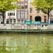 图库照片: Houseboat in Amsterdam canal