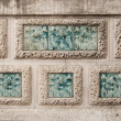 Stock Photo: Modernist flowers carving in stone wall