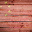 Wood texture background with colors of the flag of China — Stock Photo
