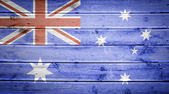 Wood texture background with colors of the flag of Australia — Stock Photo