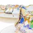 Detail of colorful mosaic in a bench of park Guell, isolated on — Stock Photo #26376283