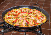 Detail of traditional spanish paella cooked in a pan — Stock Photo