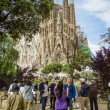 People photograph SagradFamilicathedral, designed by Antoni — Stock Photo #28144695