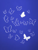 Background of white silhouettes butterflies flying — Stock Photo