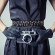 Beautiful fashion girl with an analogue photo camera — Stock Photo