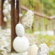 Wooden railing with hanged stones — Stock Photo
