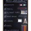 Stock Photo: Art supplies over blackboard background