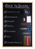 School supplies over blackboard background — Stock fotografie