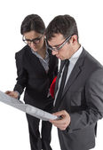 Couple of architects revising a house project on white backgroun — Stock Photo