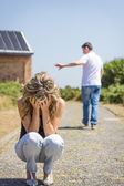 Unhappy man and angry woman leaving after quarrel — Stock Photo