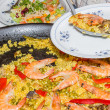 Traditional spanish paella cooked in a pan — Stock Photo