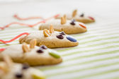 Cookies with mouse shaped and red licorice tail — Stock Photo