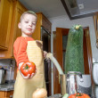 Cute child chef cooking big zucchini in a pot — Photo