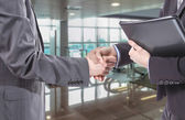 Business handshake for a closing deal — Stock Photo