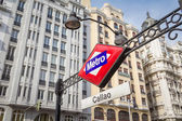 Callao metro sign over city background in Madrid — Stock Photo