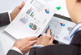 Businesswoman showing documents in digital tablet — Stock Photo