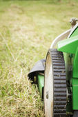 Closeup of lawnmower in the garden ready to cut — Stock Photo