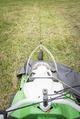 Top view of lawnmower in the garden ready to cut — Stock Photo
