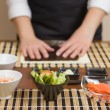 Woman chef ready to prepare japanese sushi rolls — Stock Photo #39283275