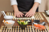 Woman chef ready to prepare japanese sushi rolls — Stock Photo